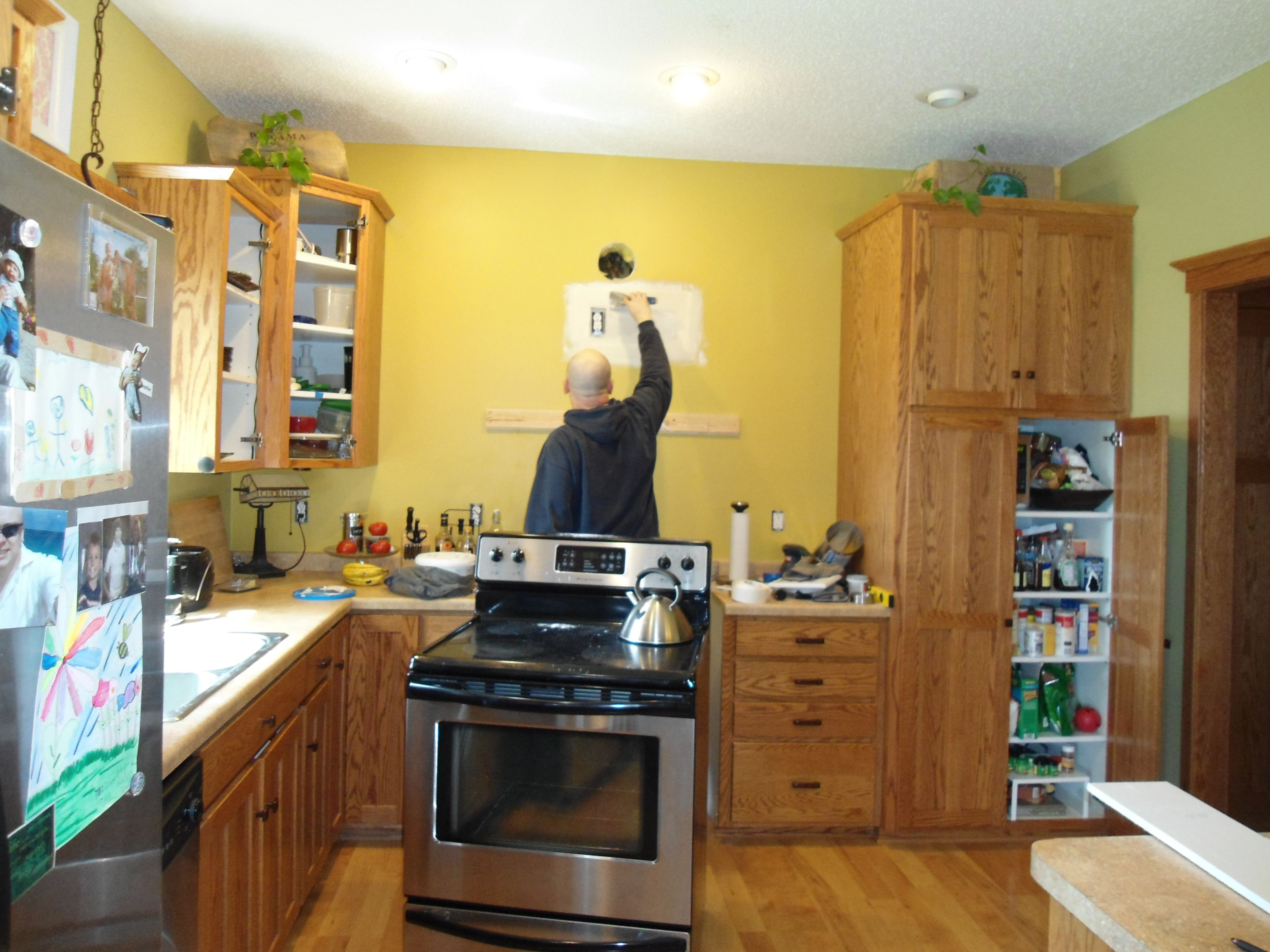 Kitchen before. The cabinets are really well made, but the oak stain ...