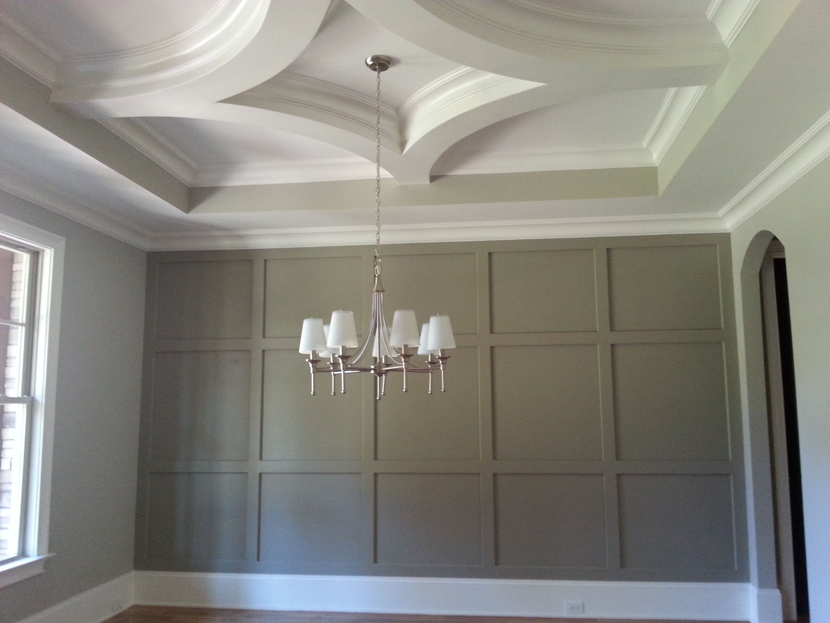 A Very Impressive Room Includes Arched Entrance Paneled Wall