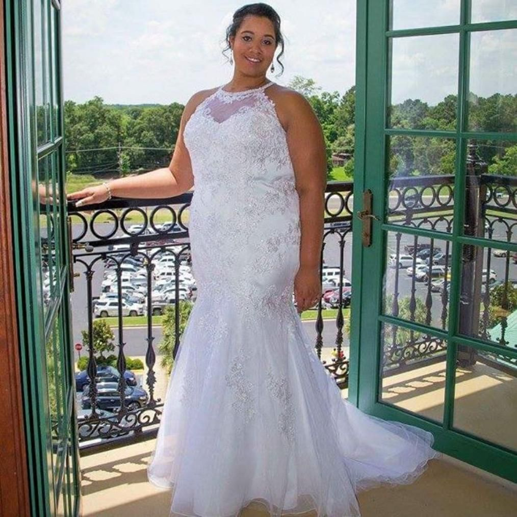 Mermaid plus size wedding dresses  The laceappliqued high illusion neckline and back of this lace and