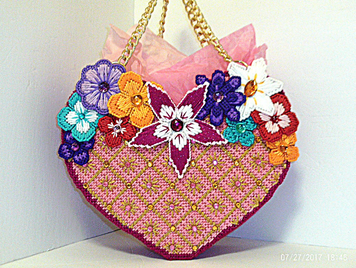 This Floral Jeweled Heart Shaped Tote Bag Is Made Of Plastic