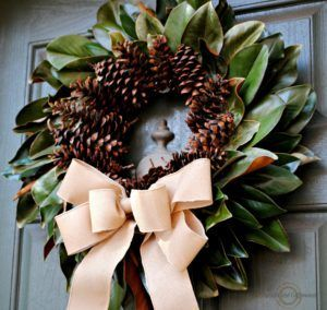 Photo of Natural autumn wreath: magnolia leaves and pine cones – upright and caffeinated