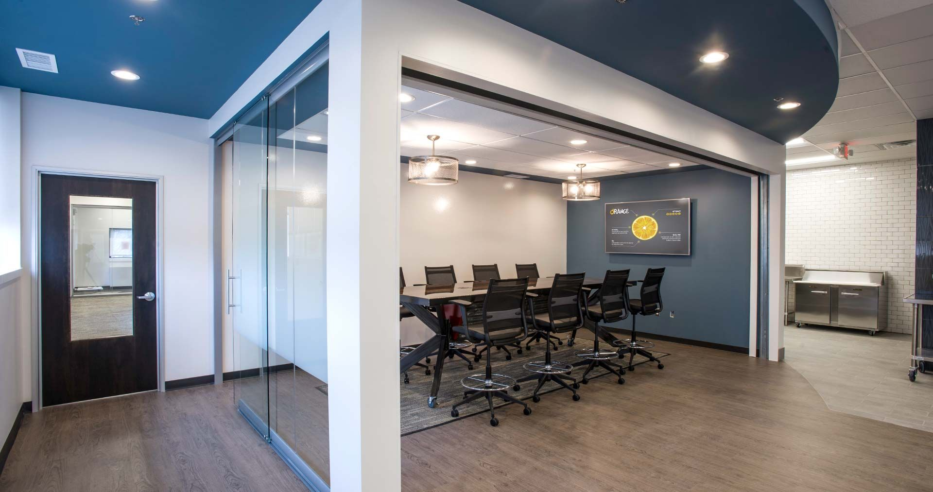 View Glass Partition By Nxtwall And Large Garage Door Create A Flexible Meeting Space The Stand Commercial Interiors Flexible Work Space Wood Conference Table