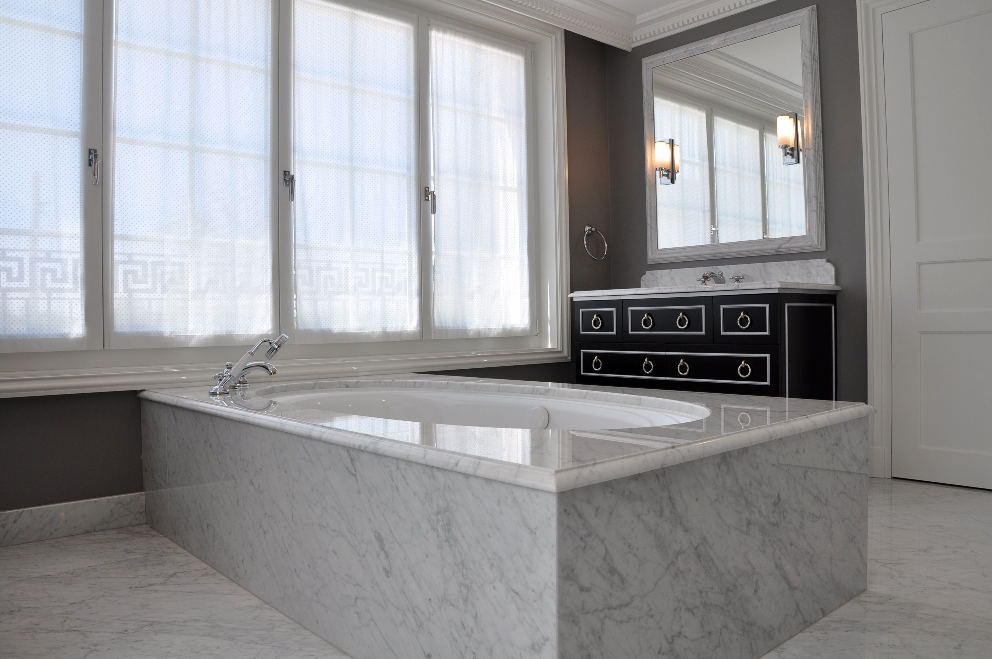Contemporary bathroom in marble and bespoke bathroom furniture
