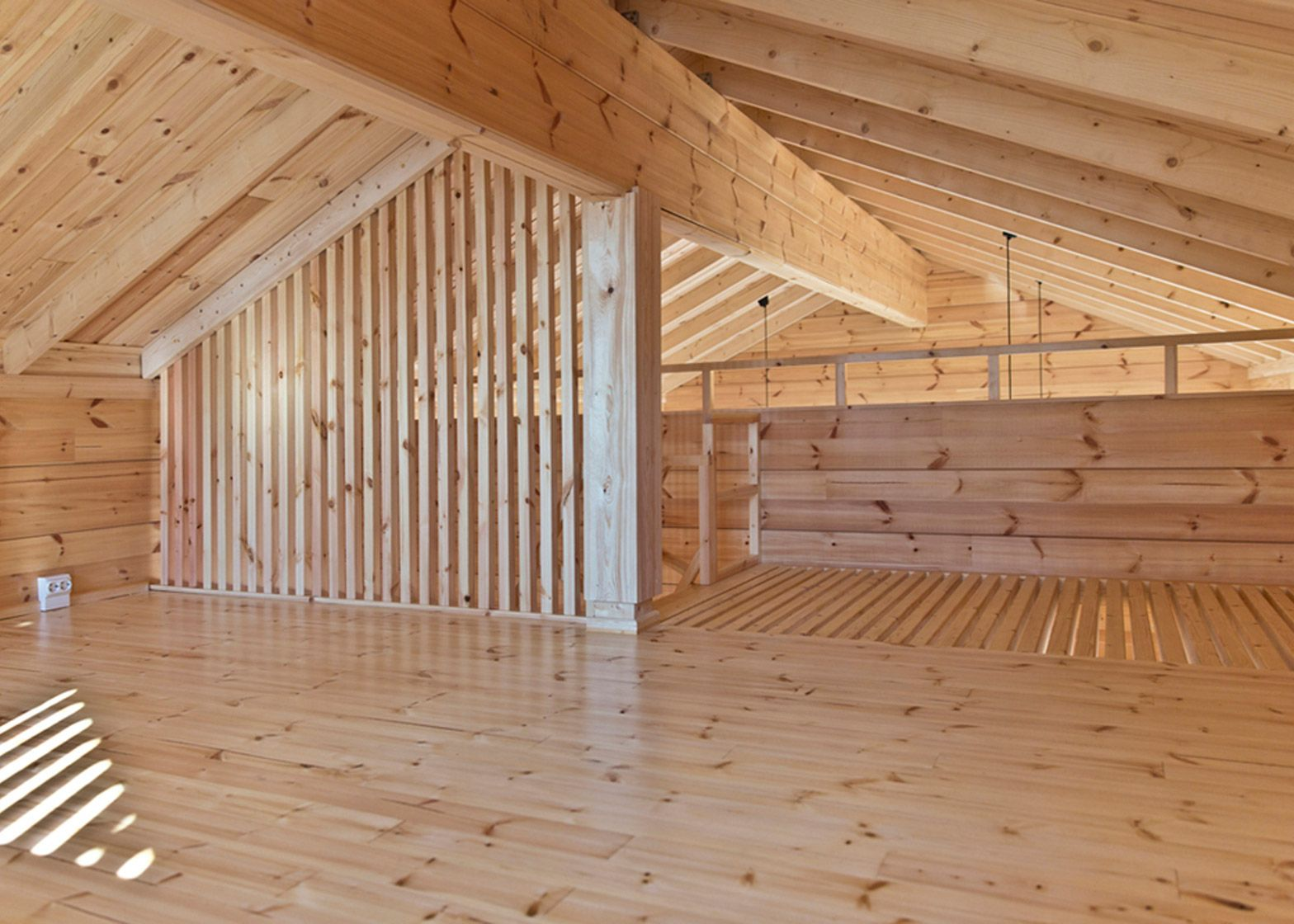 Lake cabin by Sini Kamppari features slatted timber walls and a ...