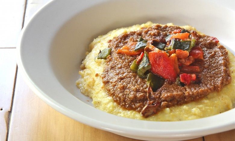 Cheesy polenta with mole and peppers stuffed peppers