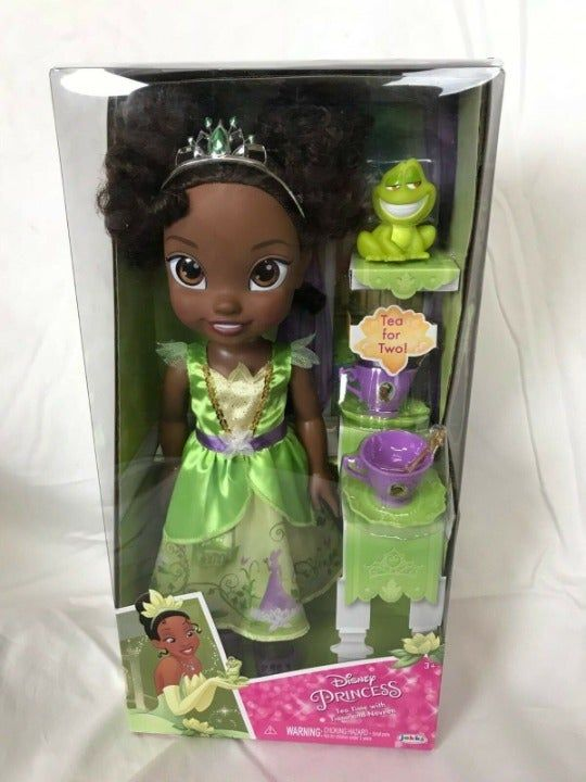 Disney Princess & the Frog Tiana Tea Time + Naveen Tea for Two Toddler Doll  Brand New In Box Disney · Ages 3 years and up Invite your friends for a perfect tea party with Ariel & Flounder.   Dressed in her royal gown and tiara, Princess Ariel wants a friend to explore with.   Share adventures together and help her become a part of your world.  Set Included:-  1 x Toddler Doll 1 x Naveen Frog 1 x Tiara 1 x Outfit 1 x Pair of Shoes 2 x Tea Cups 2 x Saucers 2 x Spoons #disneycups