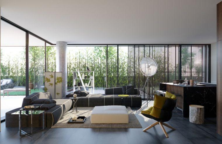 Saloni moderni e una proposta con divani nero e tavolino di vetro ...