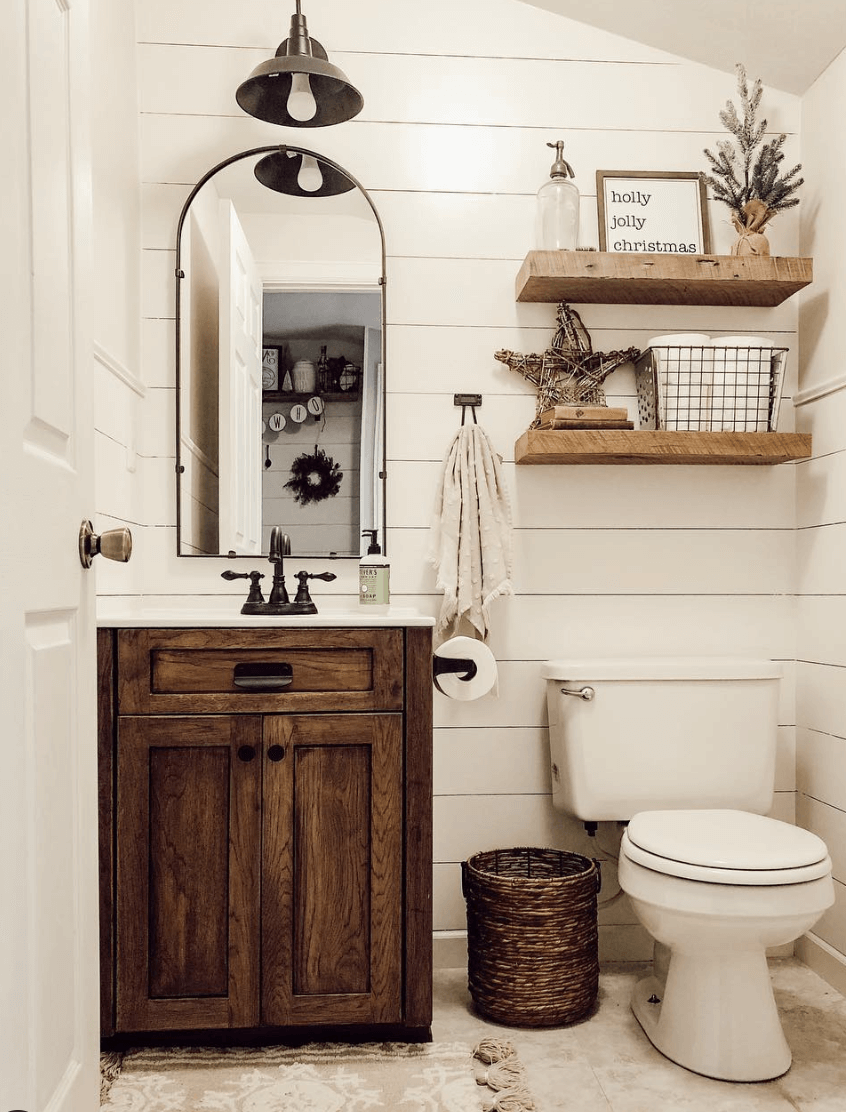 Photo of Farmhouse bathroom focuses on the functional and practical use of furniture.    …