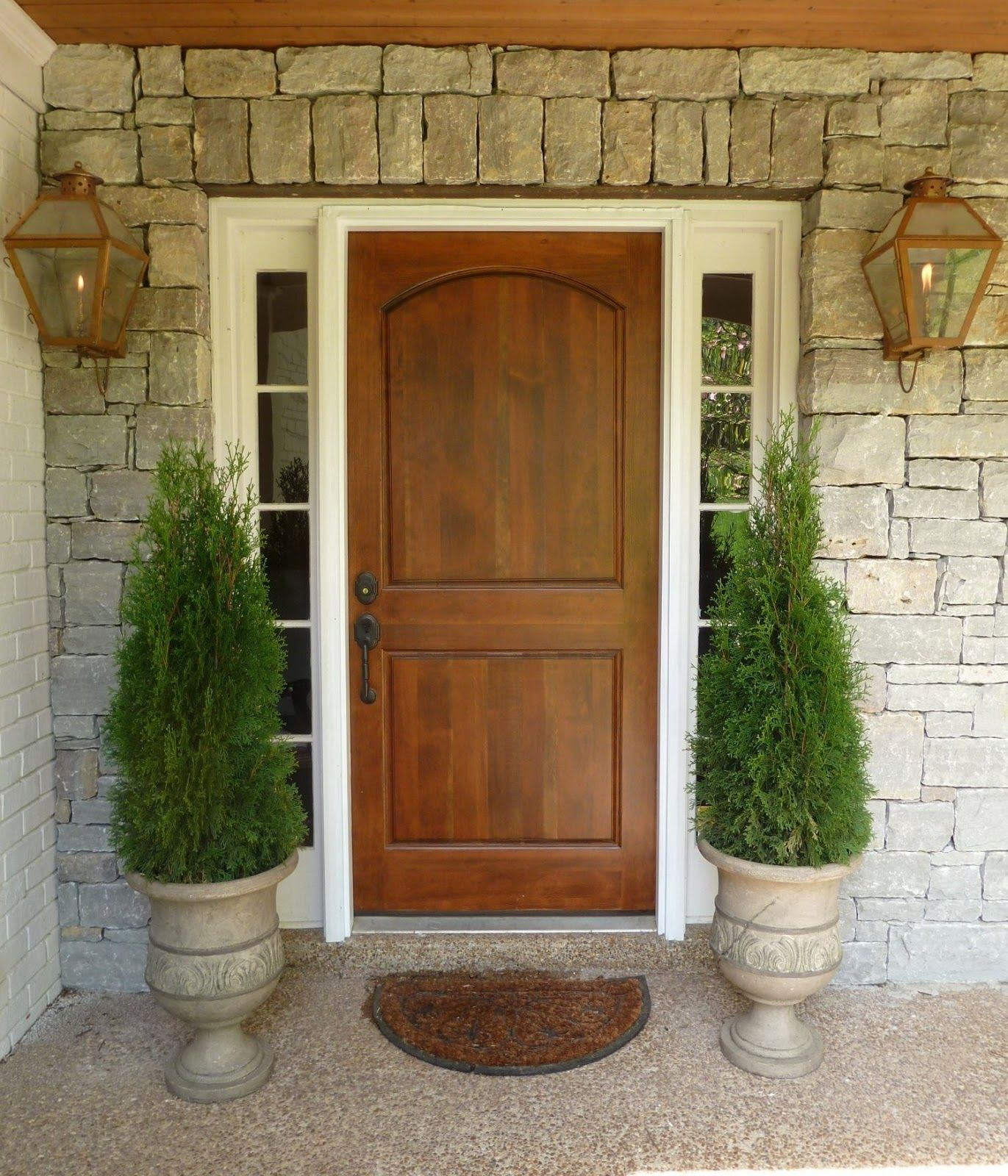 Wood Front Door, Urn Planters, Brass Carriage Lanterns