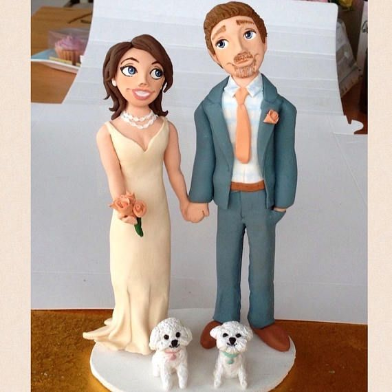 A custom cake topper made for a lovely couple and their Bichon Frises