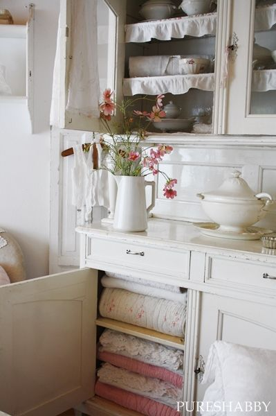 Shabby Chic.. Omg love the fabric in cabinets!