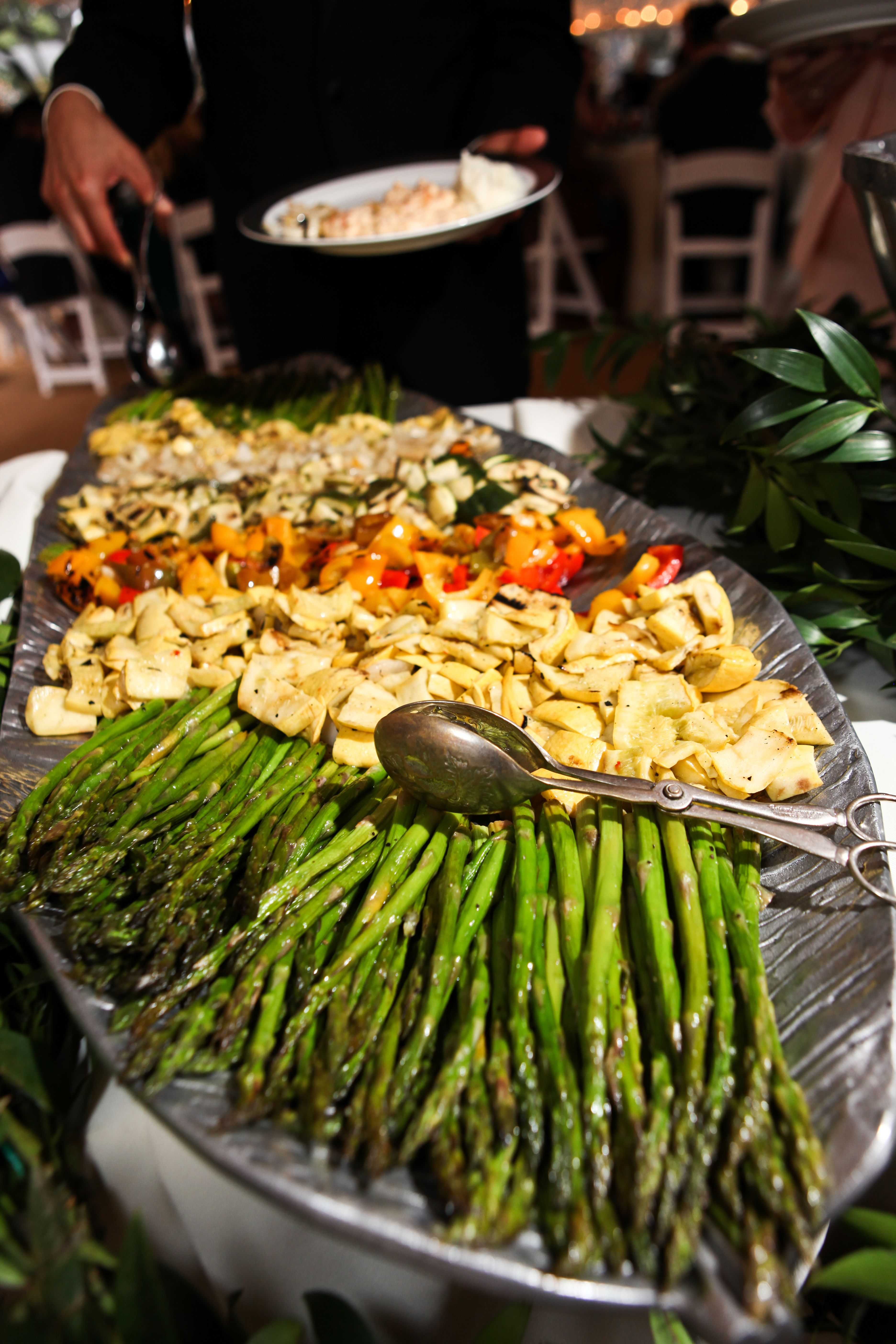 Grilled And Roasted Vegetables Are Displayed In Sections So Guests