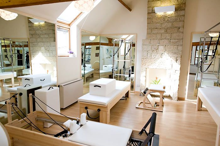 What A Beautiful Space Very Nice Use Of Mirrors To Reflect Light And The Height Of The Mirrors Was A Grea Pilates Studio Wellness Studio Pilates Yoga Studio