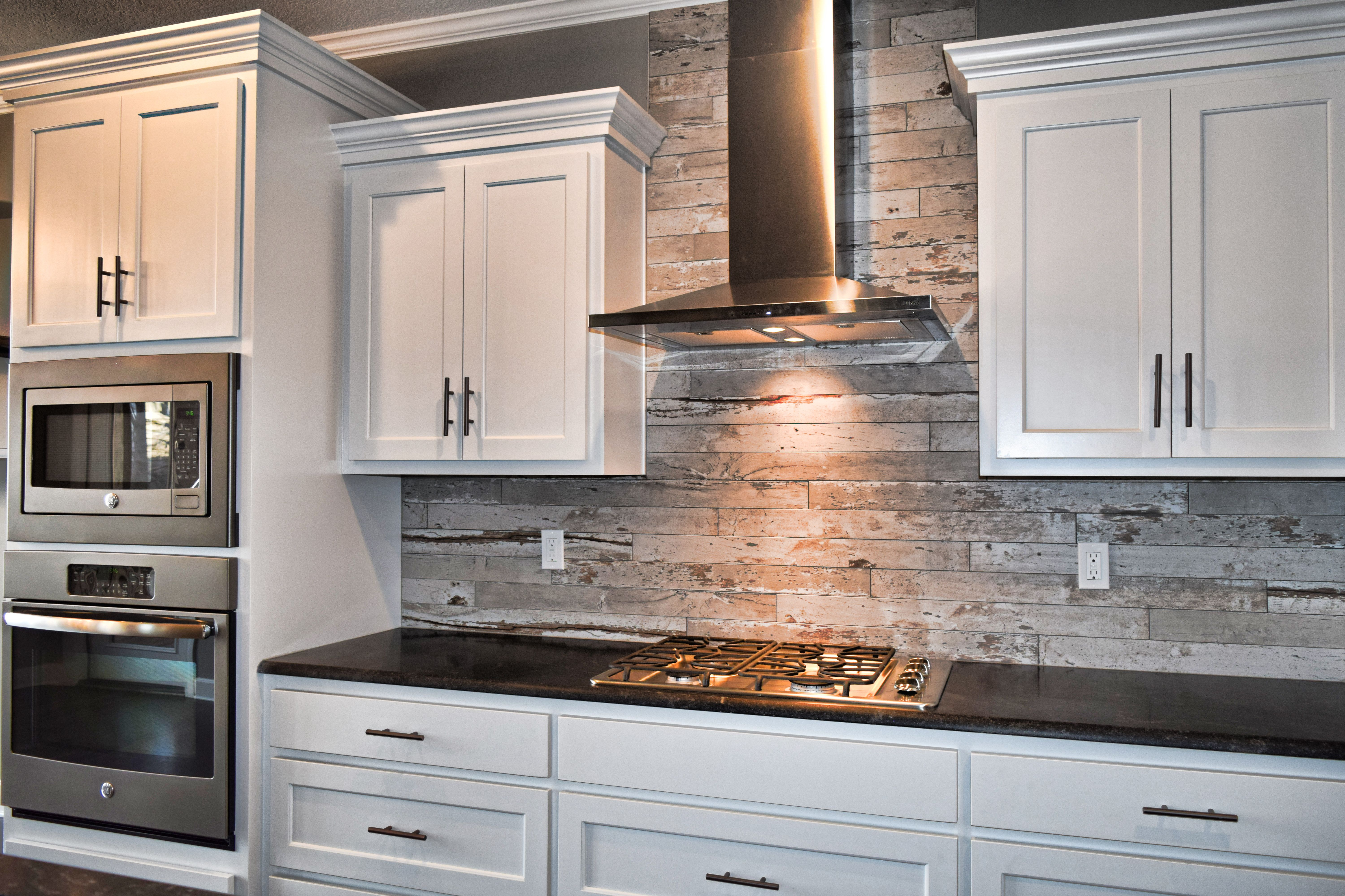 White Cabinets Wood Look Tile Kitchen Backsplash Flat Panel Cabinets White Kitche Wood Tile Kitchen Backsplash Wood Tile Kitchen Kitchen Backsplash Designs