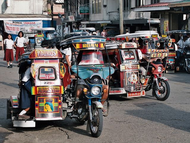 Philippines: Tricycles are designed as a cargo sidecar
