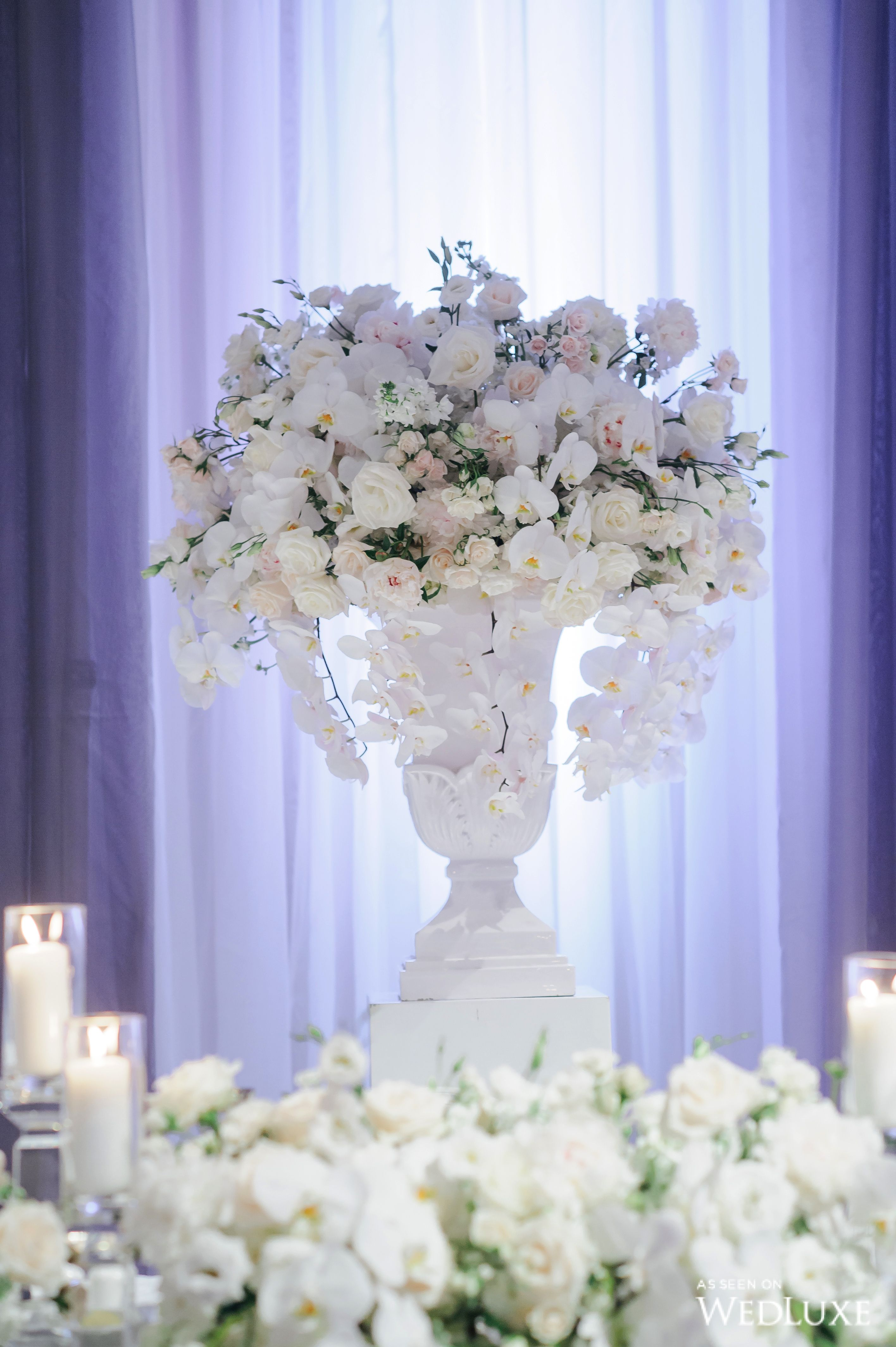 A White Wisteria And Silver Sparkle Dream Wedluxe Magazine Orchid Centerpieces Wedding Wedding Centerpieces Orchid Wedding