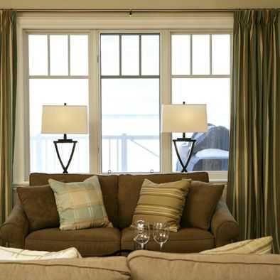 Lamps On Console Table Behind Sofa And In Front Of Window For The
