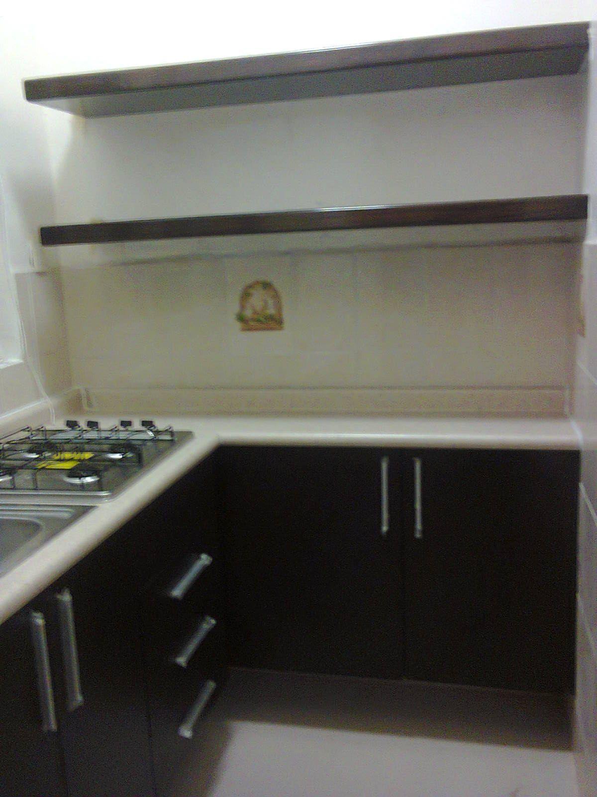 Cocina y repisas flotantes cocinas integrales muebles y for Cocinas y muebles integrales
