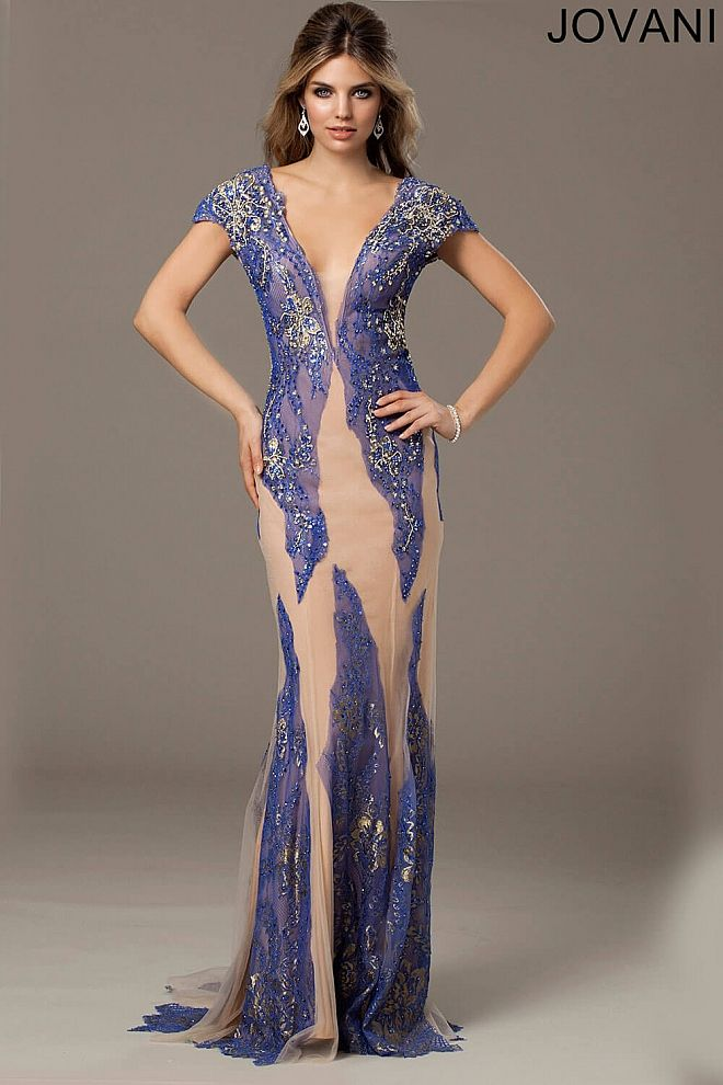 1443216cbcf Gorgeous cap sleeve dress with plunging neckline and covered in lace  appliques.