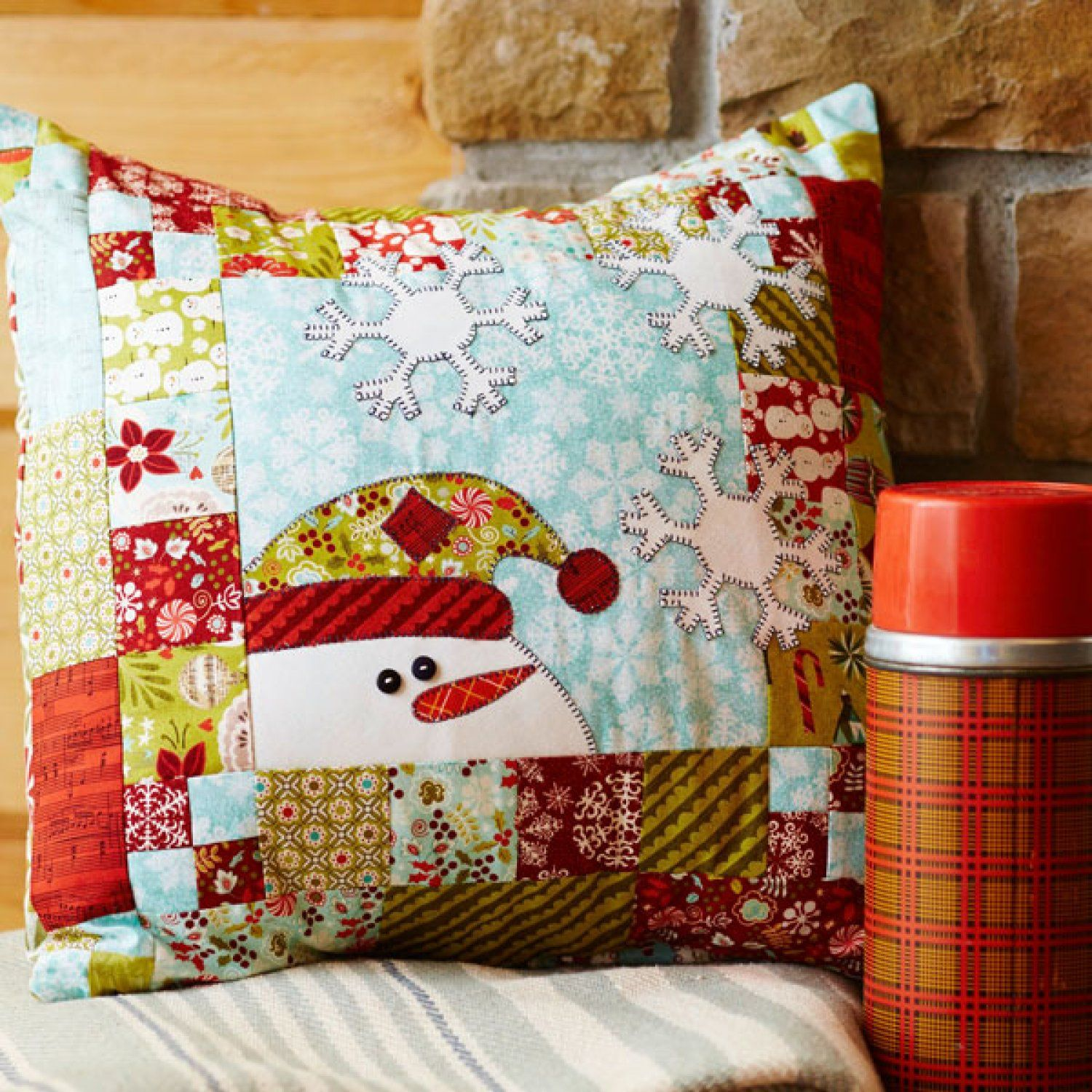 A fast-to-fuse appliquéd snowman will impart a friendly welcome all ...