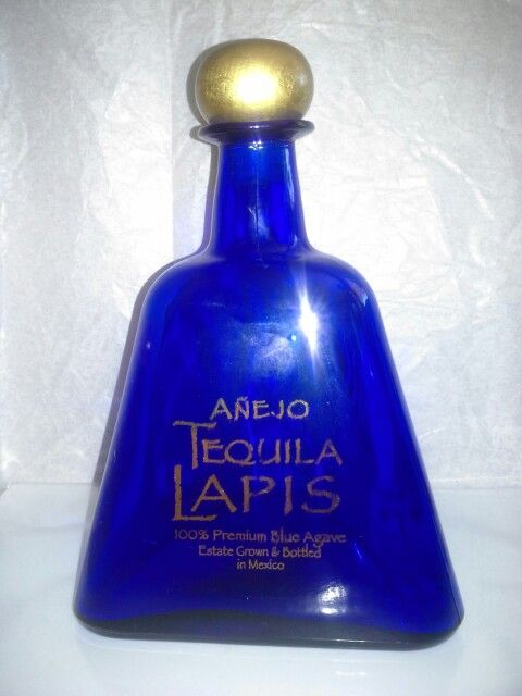 Anejo tequila lapis 750 ml. Blue triangle glass bottle