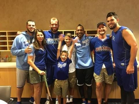The Schwab family: Michelle (second from left), Alex (center foreground), Nathan (center background) and Scott (second from right) met Royals players including Mike Moustakas, Alex Gordon, Jarrod Dyson and Eric Hosmer in August.