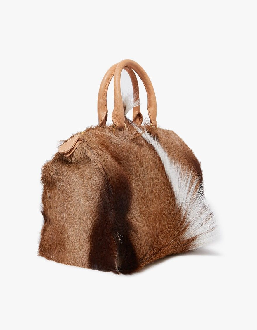 f985d4d38f Statement handbag from Brother Vellies. Signature springbok fur. Two top  handles. Top zip closure. Interior organizer panel with wall pocket and  eight card ...