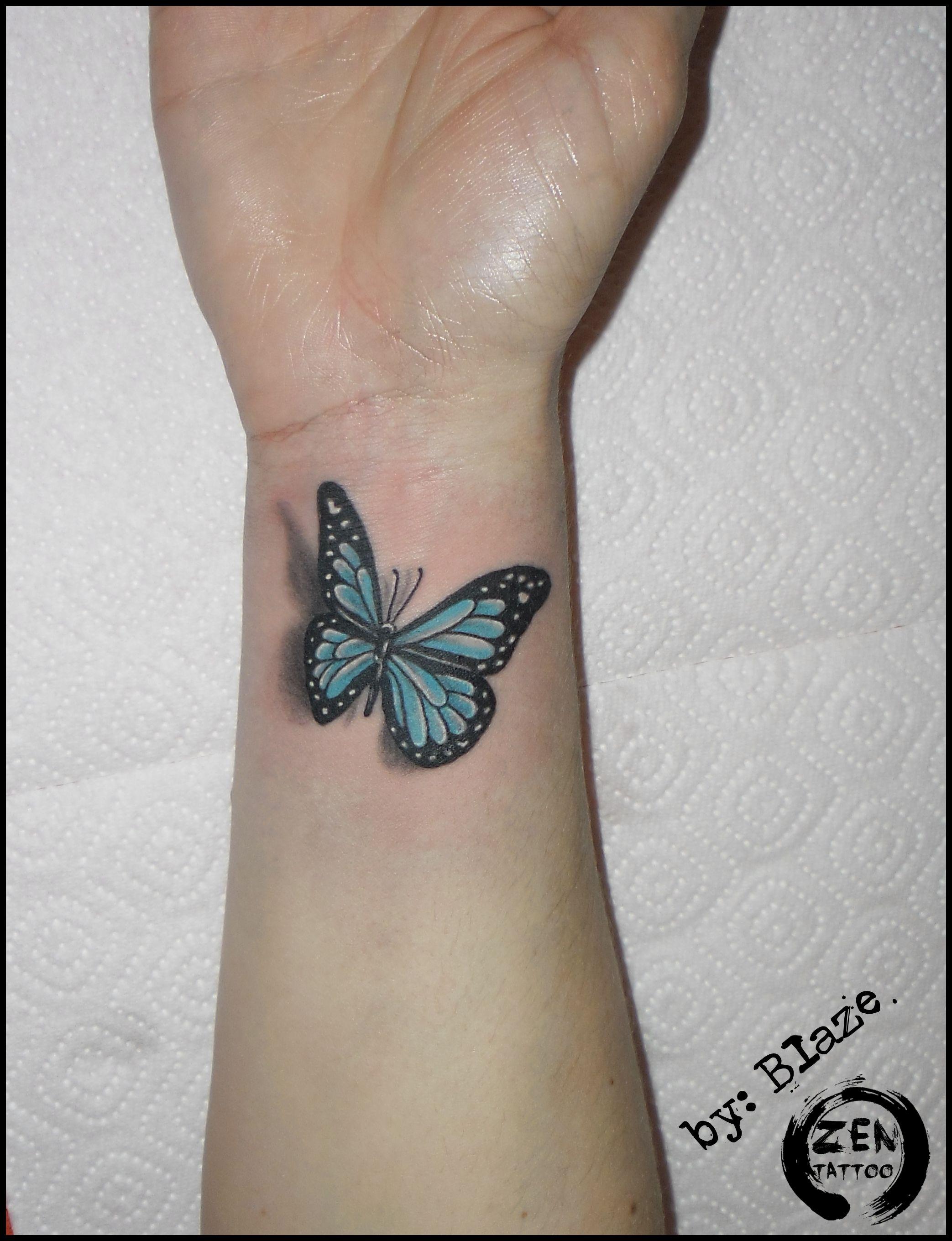 Blue butterfly; tattoo by Blaze