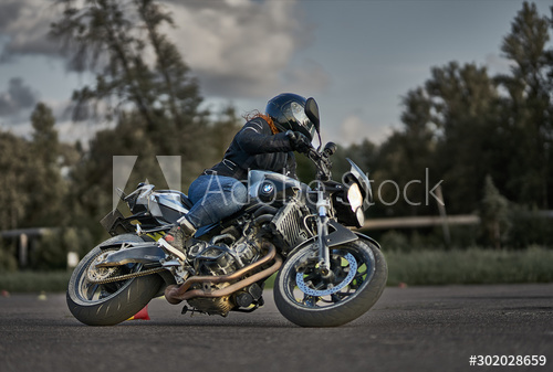 Photo of motorcycle and girl on it. Motorcyclist on bike. Girl riding motorcycle – Buy this stock photo and explore similar images at Adobe Stock