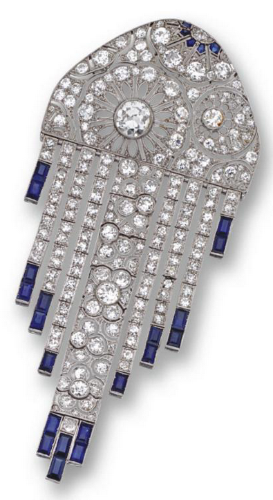 Art Deco diamond and sapphire brooch, French, circa 1920. Designed as an openwork panel decorated with stylised flowers supporting graduating articulated fringes, set with an old European-cut diamond and numerous smaller old European-cut, single-cut and rose-cut diamonds, the fringes anchored by calibré-cut sapphires, mounted in platinum, French assay marks and maker's mark. #ArtDeco #brooch