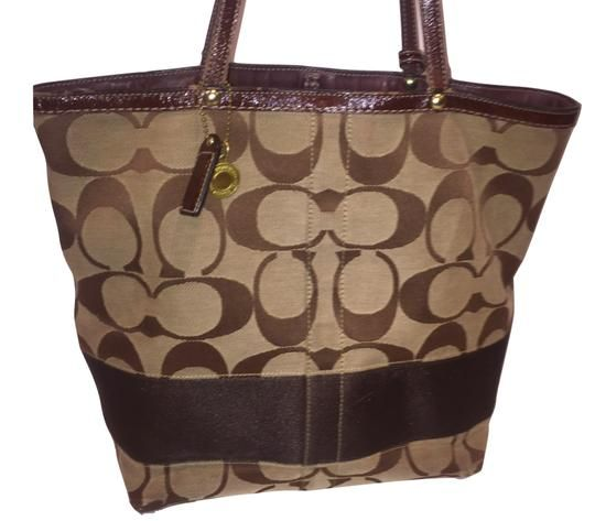 78a9ac5019 Get one of the hottest styles of the season! The Coach Signature Brown  Canvas Shoulder Bag is a top 10 member favorite on Tradesy.