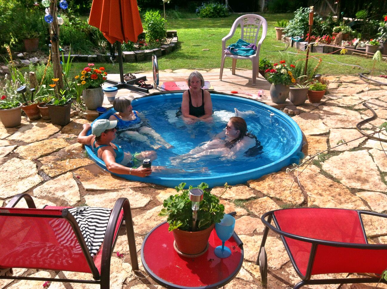 Stock tank pool would go with galvanized backyard for Plastic swimming pool garden