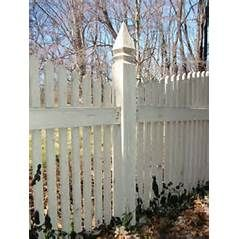 Here S A White Picket Fence Post With Decorative Top