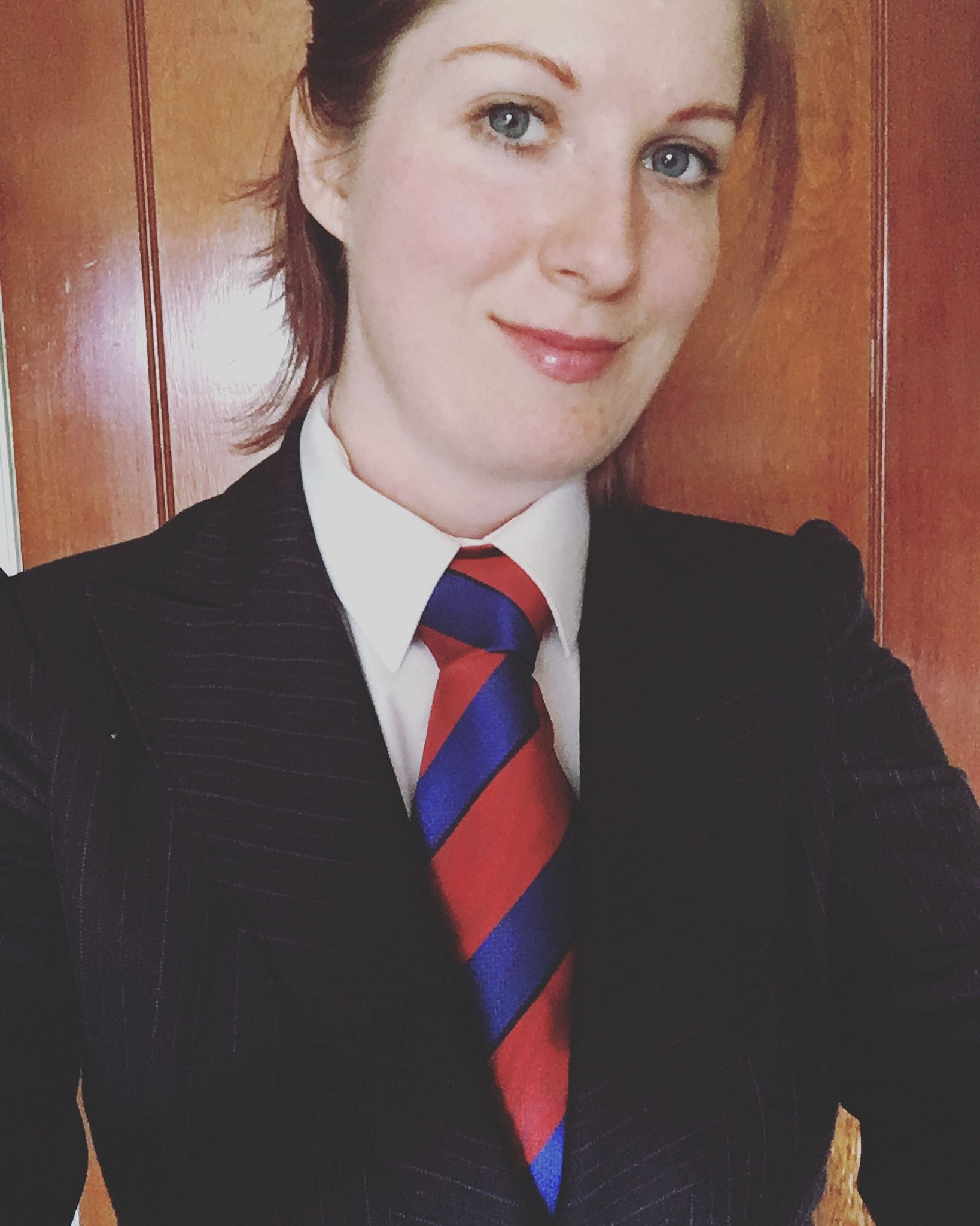 Woman Kat Surth wearing a blue and red tie | Dimples ...