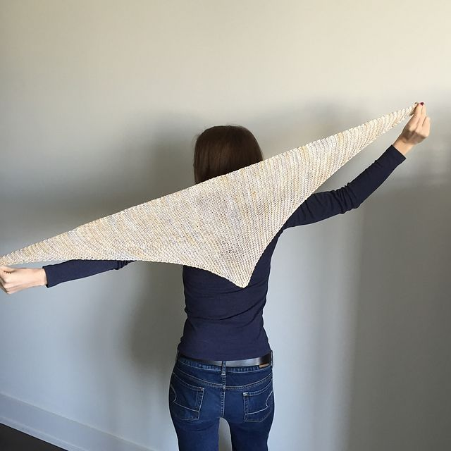 This triangular scarf is knit sideways to take advantage of the every last yard of the yarn. I tend to pick a looser needle size to make the piece draper, but you should find the gauge that works for you and your yarn.