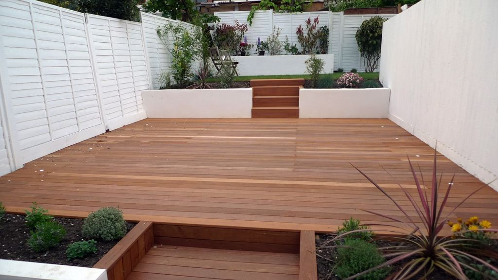 hardwood decking rendered smooth walls white fence and