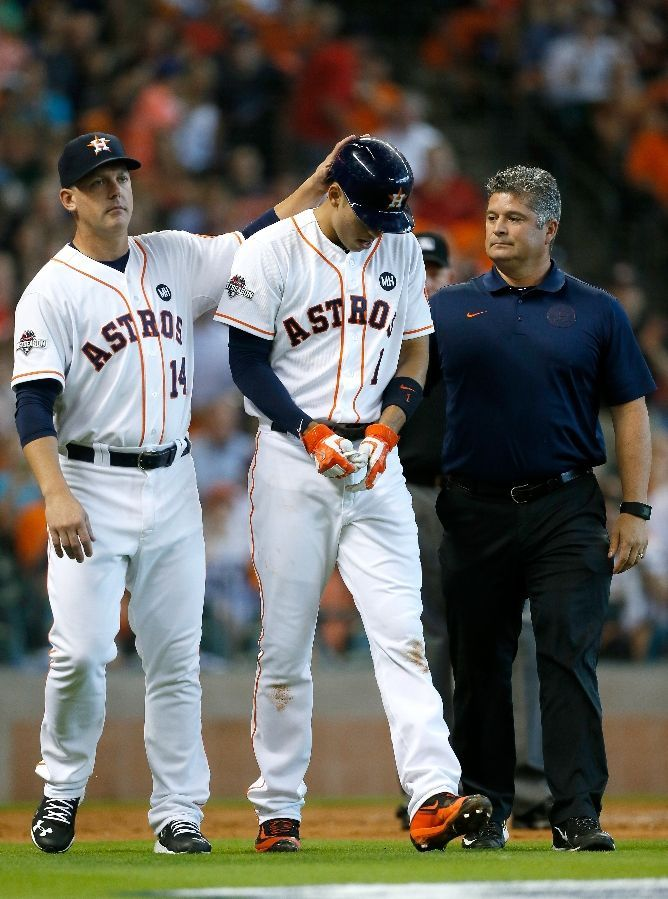 A J Hinch ,Carlos Correa, trainer Nate Lucero, after Correa HBP //Game 4 ALDS v KC, Oct 12, 2015