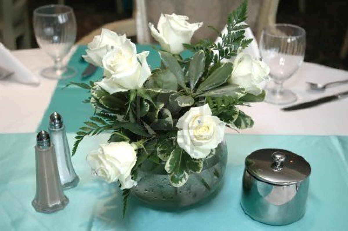 White Roses Centerpiece On Formal Dining Table