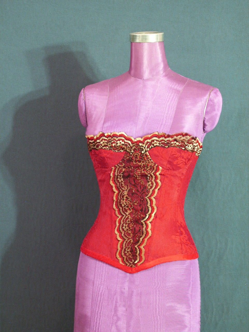 Mid-Century corset in red brocade with gold/black lace trim.  Pretty! The cups are demi so you'll get a lovely decolletage.  www.deannadesigns.biz