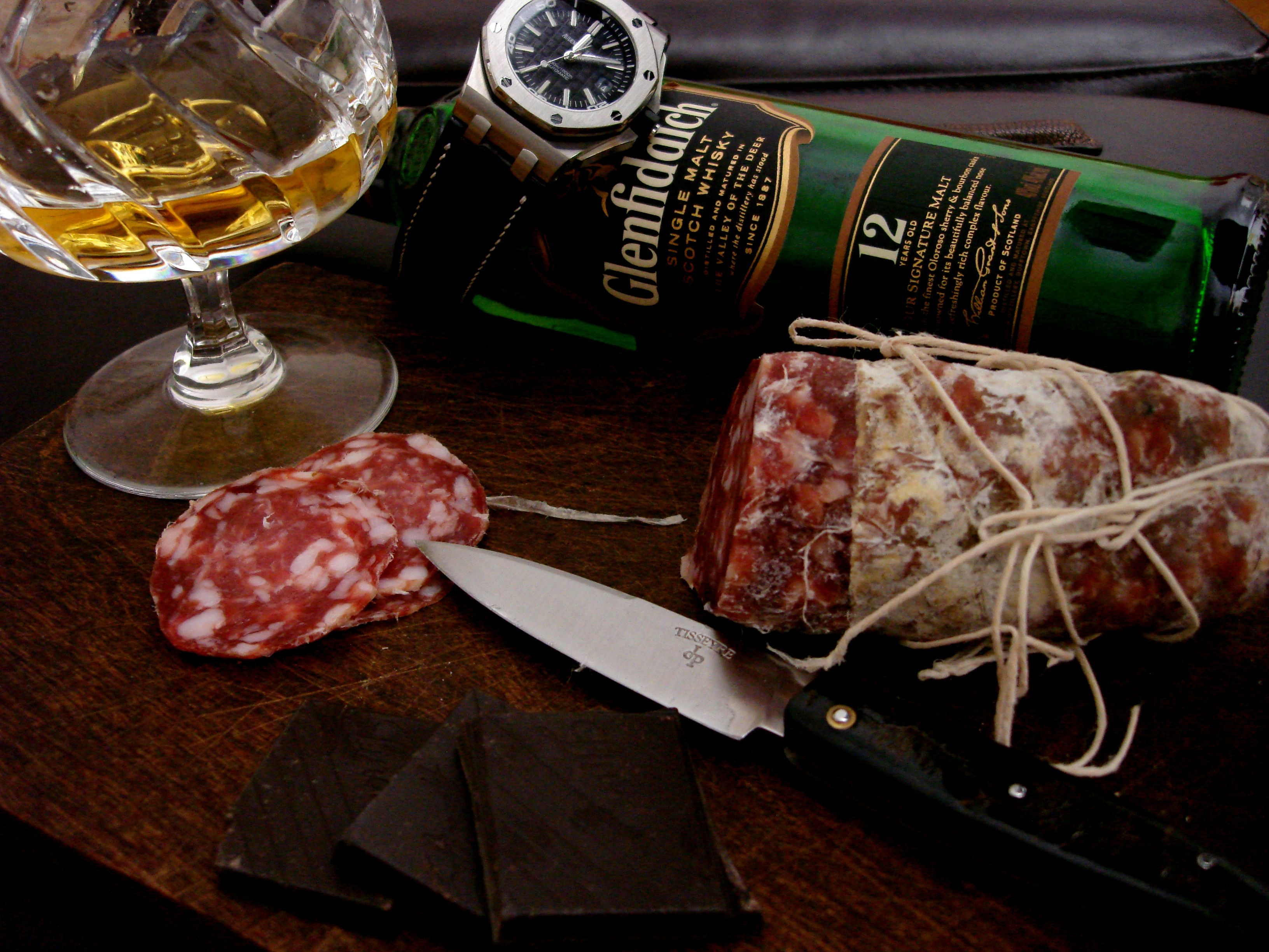 Late night snack - I love how international the world has become - Salami from Italy, Chocolate from Germany, Whisky from Scotland, Knife from France, Watch from Switzerland all on mesquite wood cutting board from the good old USA.