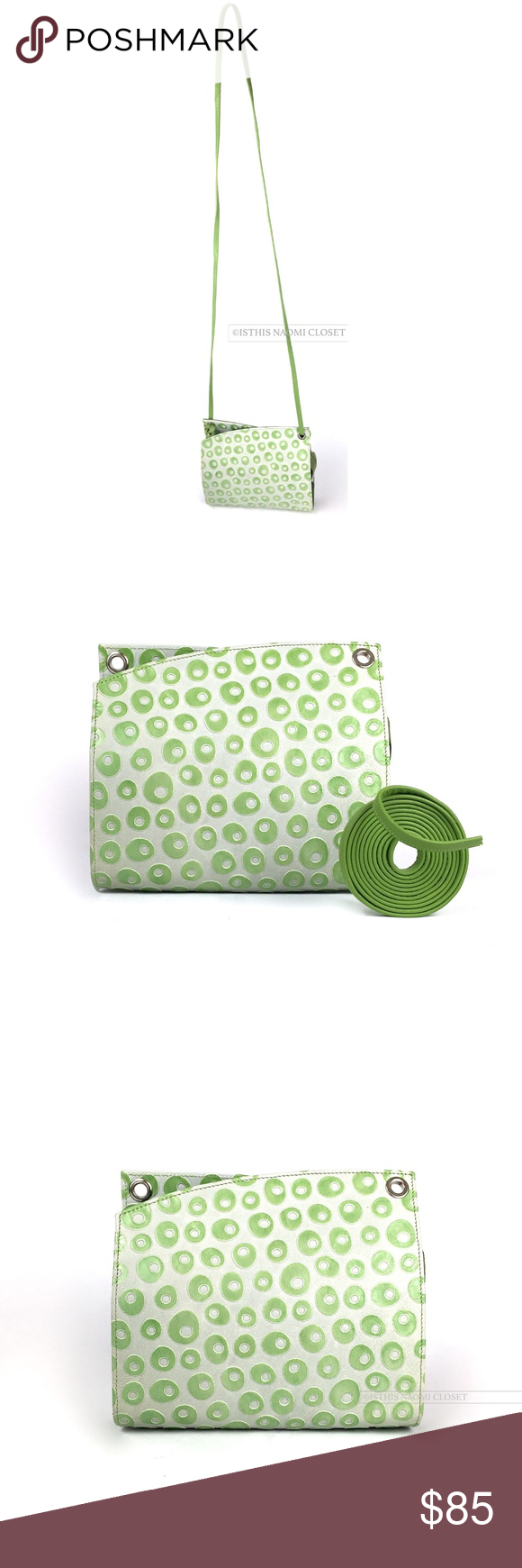 """HESTER VAN EEGHEN AmsterdamOlive Small Clutch 308. HESTER VAN EEGHEN Amsterdam Olive Green Grey Small Clutch Cross-body Purse.  Oblique designed, grey toned/ olive green circles, spaghetti  cross-body strap, silver hardware, pink inline, inlined zipped pouch. Length-~7.25,"""" Width -~1.75,"""" (With Cross-body Strap) Height-31"""", (Without Strap) Height-~6.52."""" Genlte Use. Barely noticeable (minute) inner lined, outer-shell, strap wear and base seam. Leather Material. Hester Van Eeghen Bags…"""