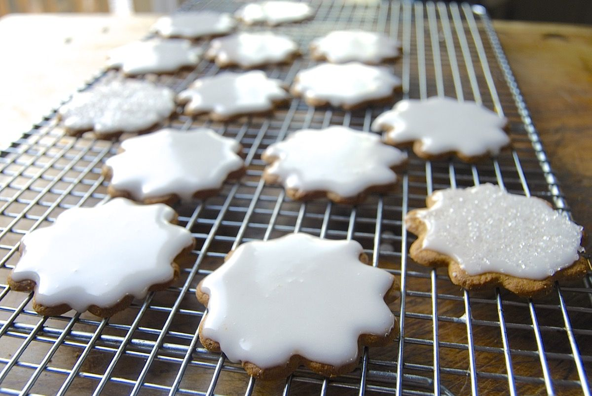 Looking for a simple cookie glaze that's the perfect base for all of your glittering sugars, holiday decorations, and piped-on designs? Here it is.