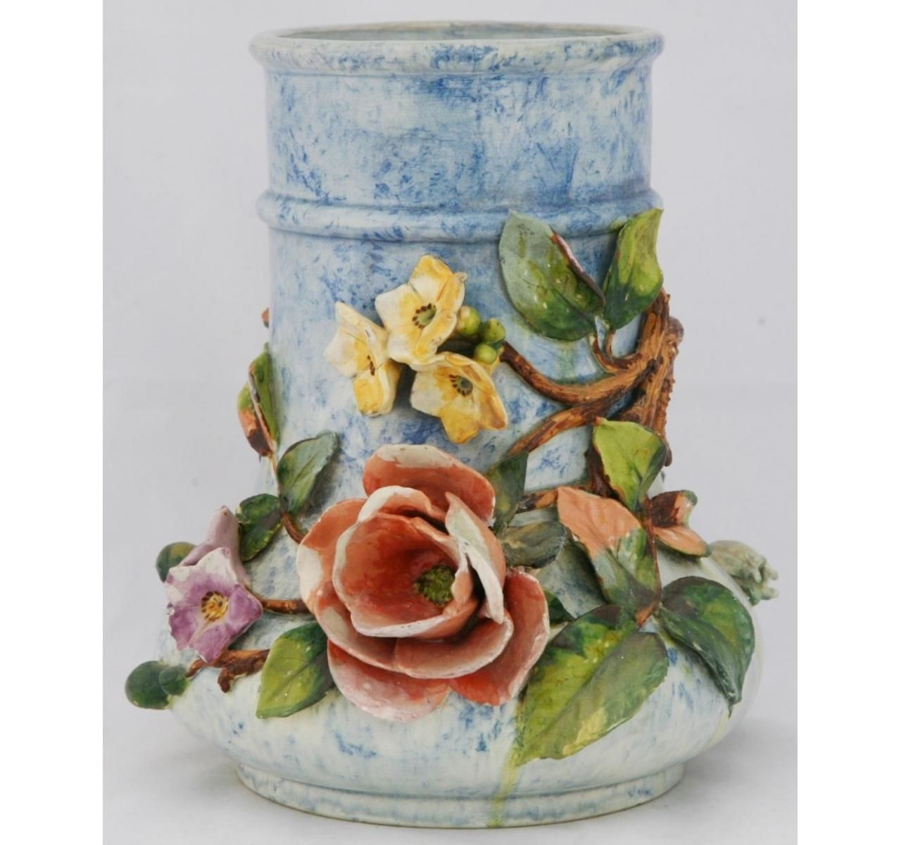 This Faience Manufacturing Company (FMC) vase stands a
