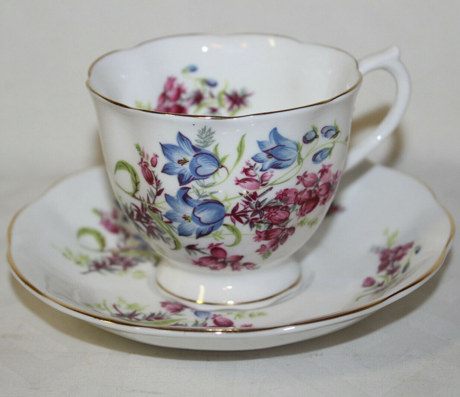 1970s Royal Albert Bone China England Cup & Saucer Royal Albert Bone China England Teacup & Saucer - Blue & Dark Pink Flowers 1970s