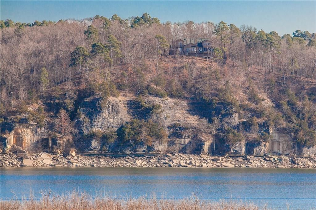 Phenomenal views of Beaver Lake from this secluded home in Rogers