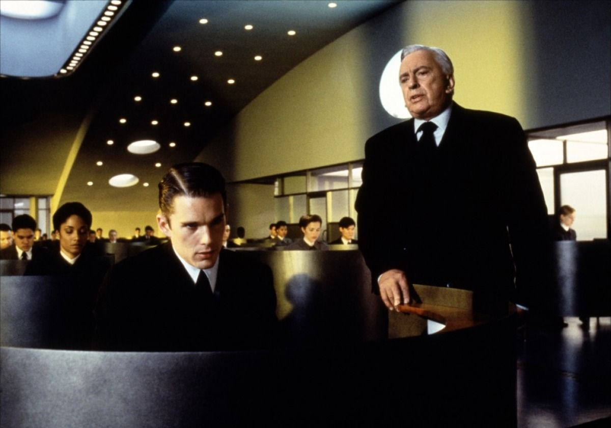 "Ethan Hawke, as a genetic 'inferior' who has assumed another man's more impressive DNA profile, shows distress under his employer's oversight in this ""GATTACA"" film still. (Credit: Columbia Pictures Corporation, 1997)"