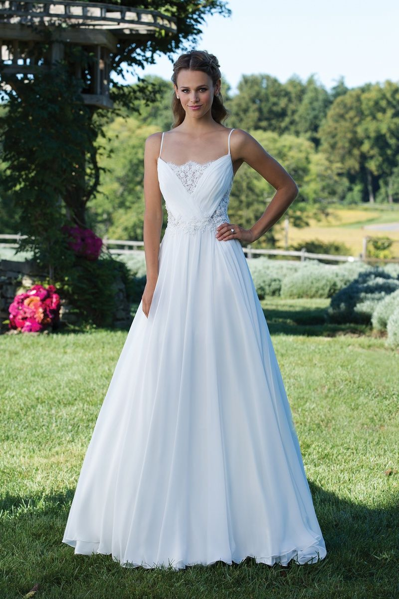 Sincerity bridal chiffon and chantilly lace gown with cut outs and