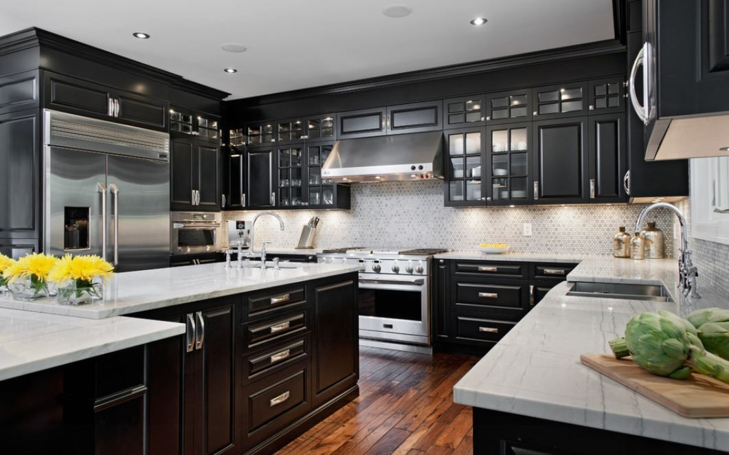 Elegant Kitchen Featuring Black Cabinets With White Countertops And Stainless Steel Liances Durable Por