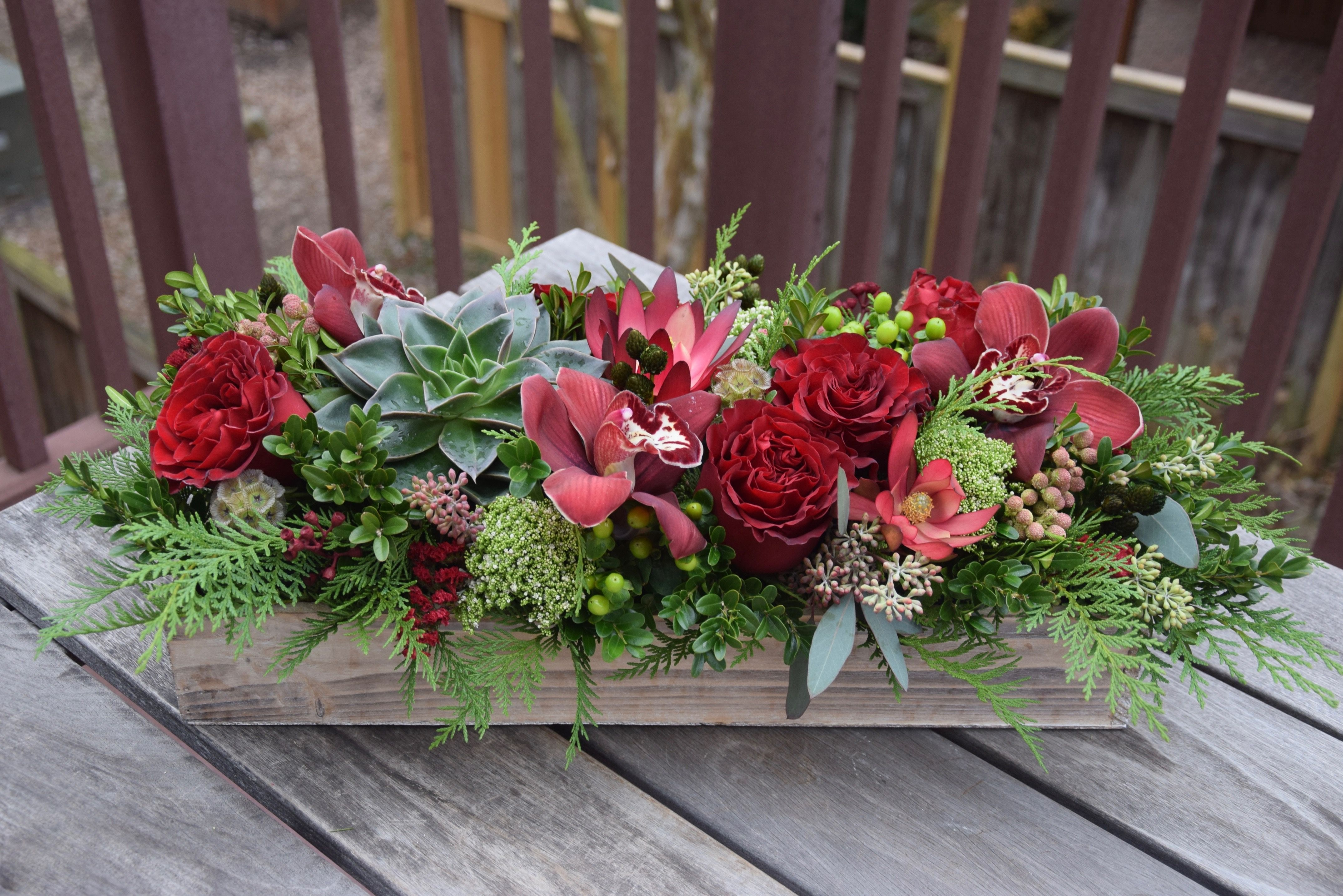 Long And Low Masterpiece With Succulent Heart Roses Cymbidium