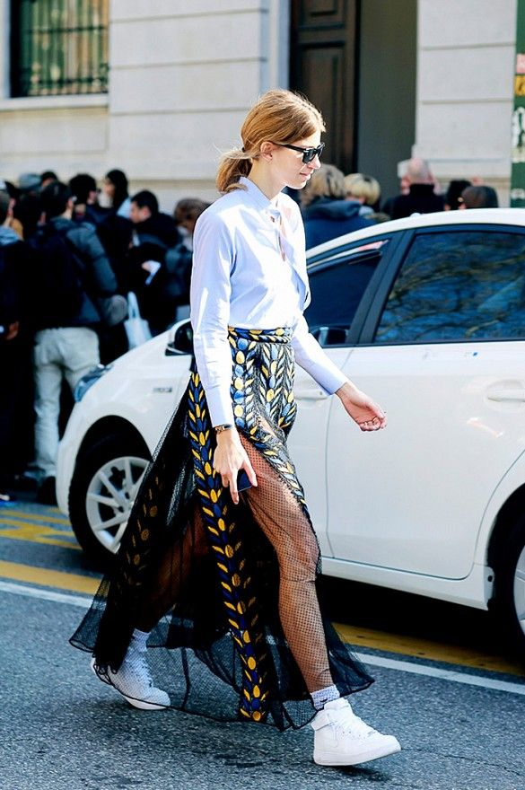 Make a fun and flirty skirt more casual by pairing it with white sneakers. // #StreetStyle